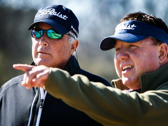 Professional golfer Curtis Strange, left, and golf course designer Randy Wilson look for water hazard improvements at Colonial Country Club's South Course.