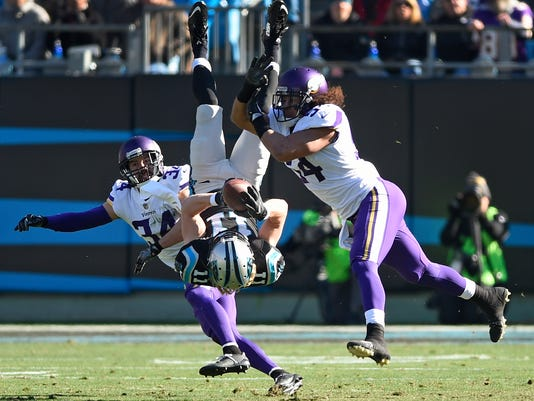 Carolina Panthers' Brenton Bersin (11) is upended by Minnesota Vikings' Andrew Sendejo (34) and Eric Kendricks (54) during the first half of an NFL football game in Charlotte, N.C., Sunday, Dec. 10, 2017. (AP Photo/Mike McCarn)