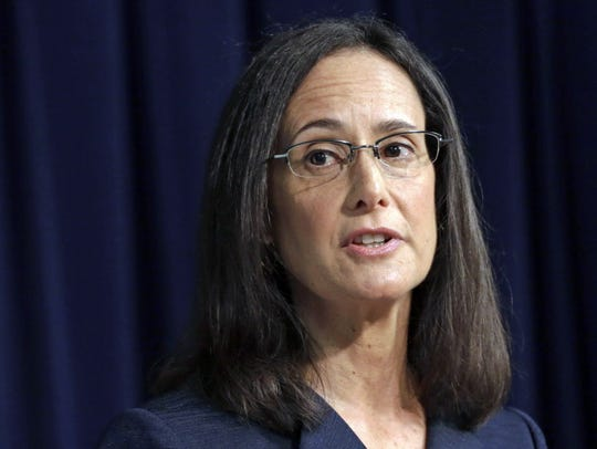 Illinois Attorney Gen. Lisa Madigan speaks during an August 2014 news conference in Chicago.