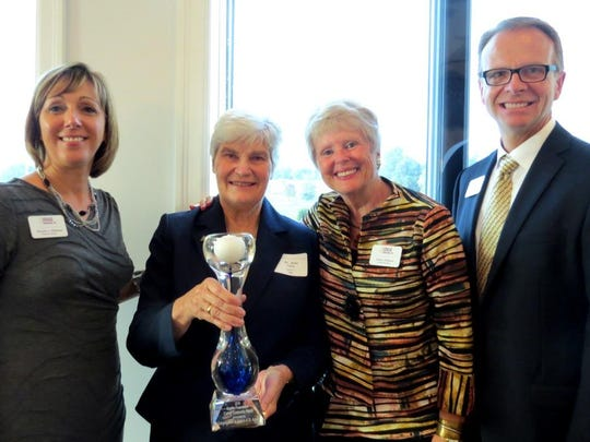 The Congregation of the Sisters of St. Agnes receives the Sophia Foundation's 2016 Caring Community Award.  Pictured from left are Christa Williams, Sister Jean Steffes, Virginia Gilmore and William Wuske.