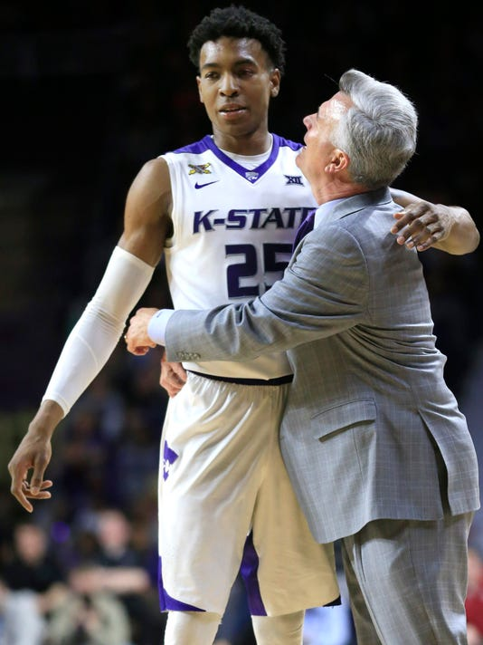 Kansas State head coach Bruce Weber, right, hugs forward Wesley Iwundu (25) during the second half of an NCAA college basketball game against Oklahoma at Bramlage Coliseum in Manhattan, Kan., Saturday, Feb. 6, 2016. Iwundu scored 22 points in the game. Kansas State defeated Oklahoma 80-69. (AP Photo/Orlin Wagner)