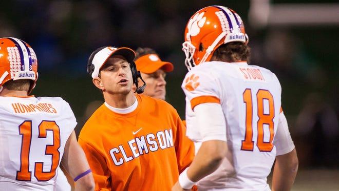Clemson head coach Dabo Swinney celebrates a touchdown with quarterback Cole Stoudt.