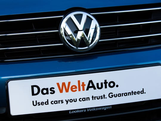 Used cars by Volkswagen are parked at a dealership
