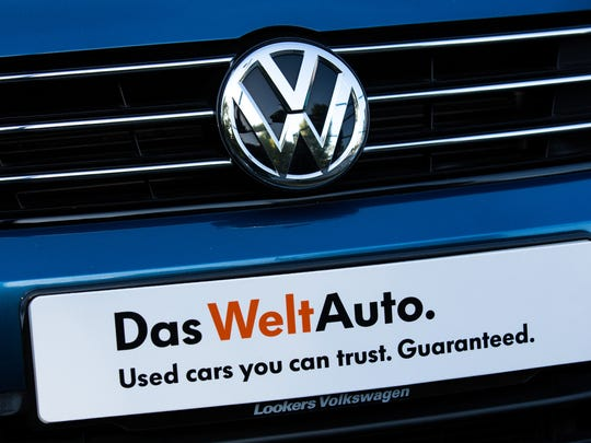 Used cars by Volkswagen are parked at a dealership in Battersea on September 25, 2015 in London, England.