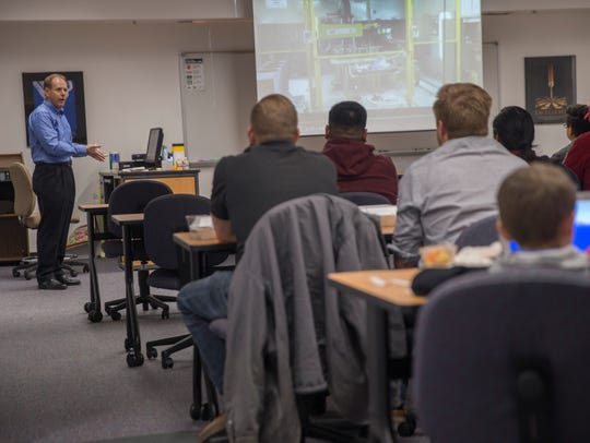 Chris Ziomek, left, managing partner with Build with Robots, delivers a presentation on robots Tuesday at the San Juan College Quality Center for Business in Farmington.