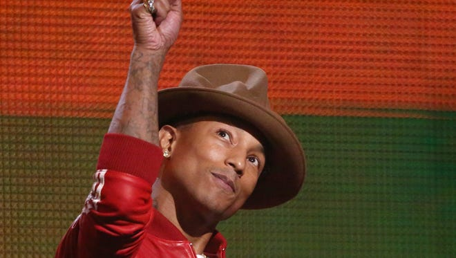 Presenter Pharrell Williams gestures on stage at the 56th annual Grammy Awards at Staples Center on Jan. 26, 2014.