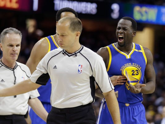 Golden State Warriors forward Draymond Green (23) yells at referee John Goble during the first half against the Cleveland Cavaliers in Game 4 of basketball's NBA Finals in Cleveland, Friday, June 9, 2017. (AP Photo/Tony Dejak)