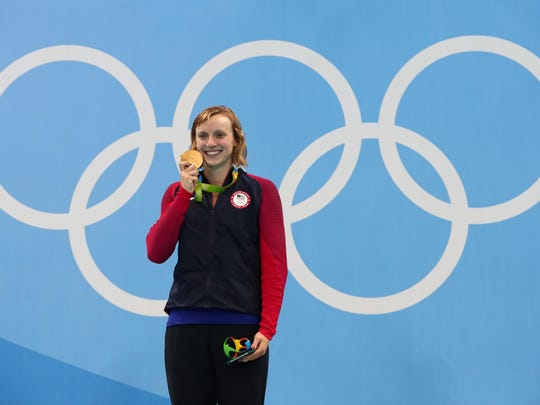 Katie Ledecky (USA) celebrates after winning the gold medal in the women's 800m freestyle final at Olympic Aquatics Stadium.