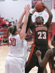 Mansfield Senior's JayJahne Feagin shoots over Shelby's