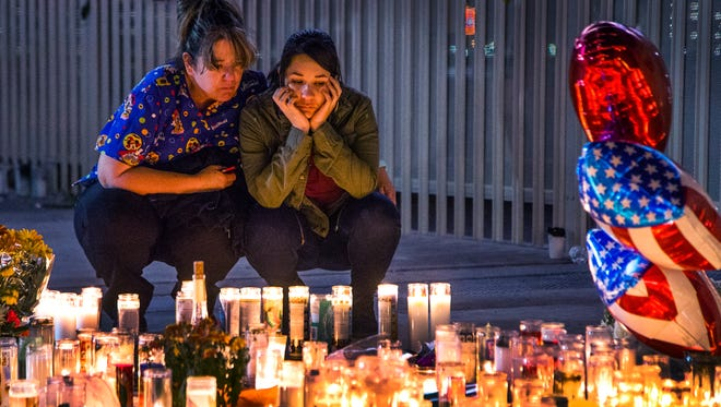 A memorial is growing on the Las Vegas Strip in remembrance of the 58 souls lost in the Oct. 1, 2017, massacre. Laura Rodriguez and her daughter, Sara Rivero, 23, both of Las Vegas, pay their respects on Oct. 3, 2017.