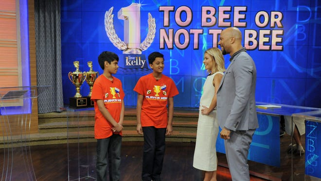 "Kelly Ripa and rapper Common join Scripps National Spelling Bee co-champions Nihar Janga, left, and Jairam Hathwar during the production of ""Live With Kelly""  on Tuesday."