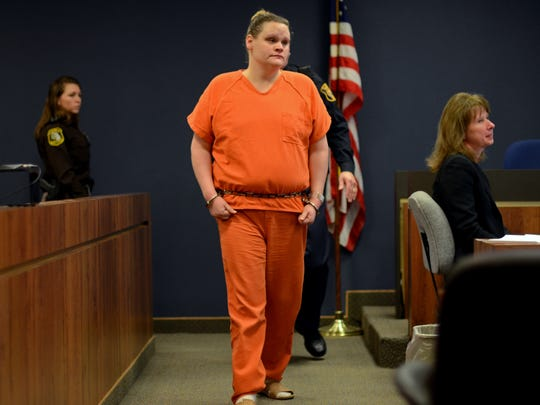 Elizabeth Long enters the courtroom Monday, Feb. 8,