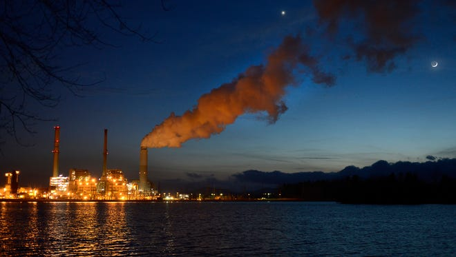 Duke Energy's Lake Julian plant is shown at night in this file photo.