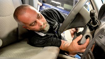 A technician changes out a General Motors ignition switch during the recall