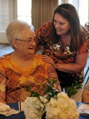 Aimee Brown, left, visits with her friend,Donna Propest, during the 2016 Give Light Awards ceremony. Brown received a Volunteer of the Year award for her long time service at Floral Heights Community Food Pantry.