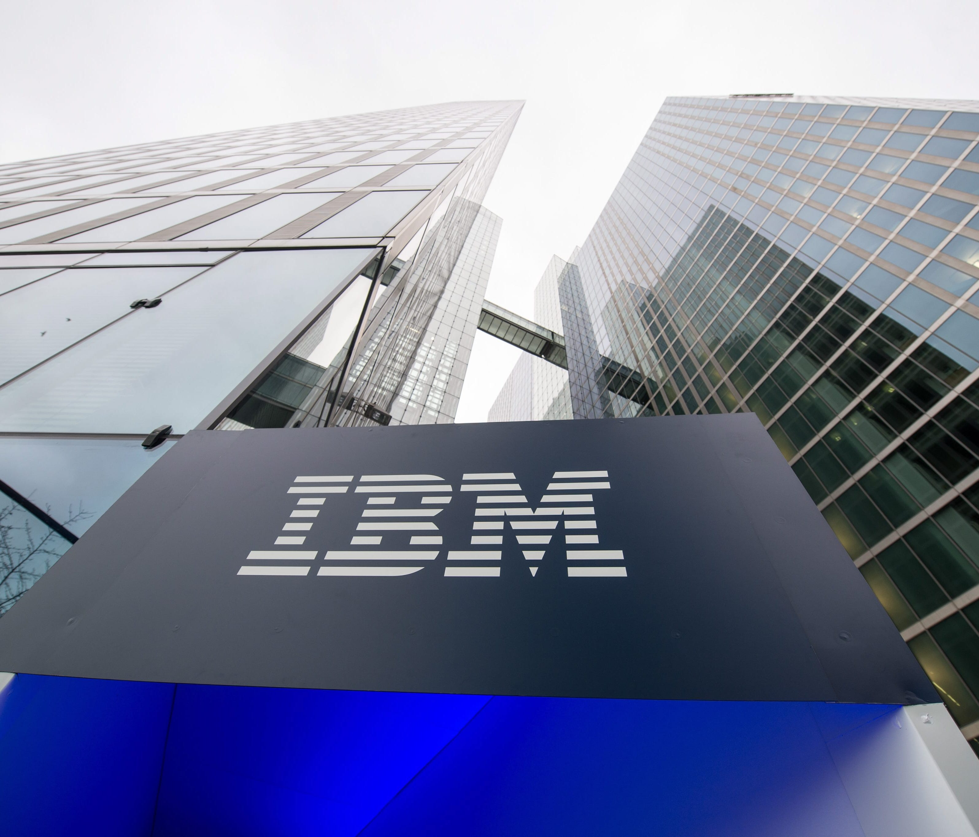 A file photo dated 15 December 2015 showing the logo of IBM seen at the entrance to the Highlight Towers inMunich,Germany. Technology corporation IBM is to release their 4th quarter results on 19 January 2016.