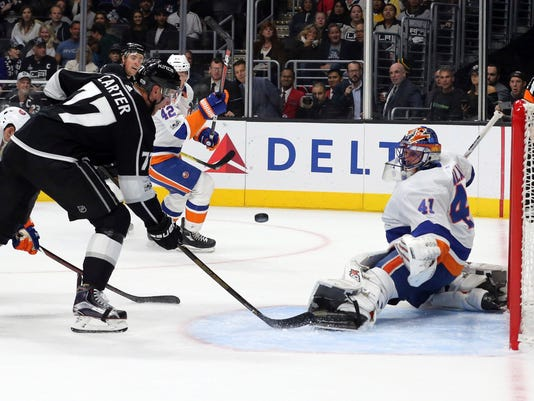 New York Islanders goalie Jaroslav Halak (41) defends at Los Angeles Kings center Jeff Carter (77) moves in in the second period of an NHL hockey game in Los Angeles Sunday, Oct. 15, 2017. (AP Photo/Reed Saxon)