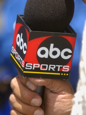 5/26/02 (Photo by Matt Detrich) w/ story file #70810 slug:  Indy27 // The 86th Indianapolis 500 race // ABC Pit Reporter Jack Arute holds the famed microphone with the ABC logo while trying to stay on top of the stories of the day.