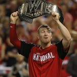 Reds third baseman Todd Frazier raises a championship belt after winning the Home Run Derby.