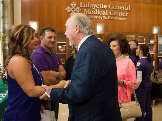 Dondie Breaux, mother of Mayci Breaux, is greeted by Bo Ramsay after a press conference announcing the Mayci Breaux Scholarship Fund at Lafayette General Hospital July 14, 2016.