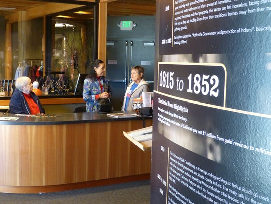 Margaret Gallego, right, chats with Wintu Cultural