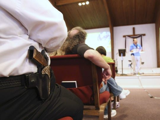 A man wears a firearm in a Kentucky church. Church security has become a hot topic after deadly shootings at houses of worship.