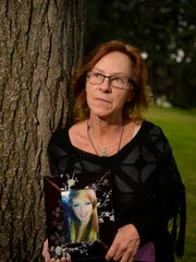 Donna Smith Nelson holds a picture of her daughter,