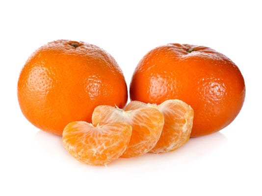 whole murcott mandarin orange on white background