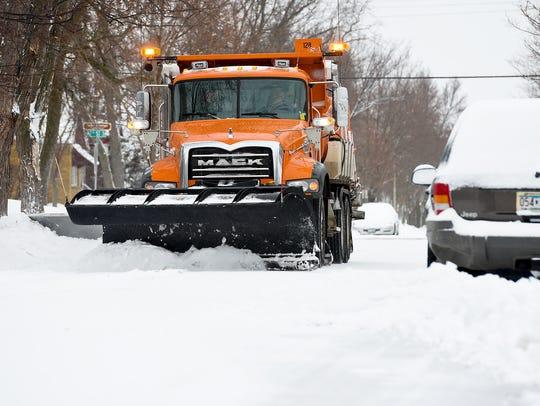 St. Cloud Public Works Department snowplows clear snow