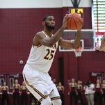 Iona's Aaron Roundtree (25) put-up a shot during a mens basketball game against Delaware at the Hynes Center at Iona College in New Rochelle on Friday, Nov. 20, 2015.