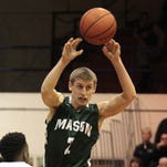 Eddie Puisis scored a game-high 16 points as Mason defeated Middletown 68-57 Tuesday. The Comets improved to 18-1 this season as coach Greg Richards won his 300th game.