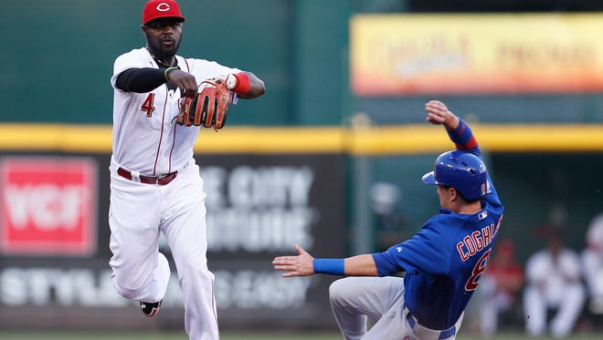 Reds second baseman Brandon Phillips turns a double play in August against the Cubs.