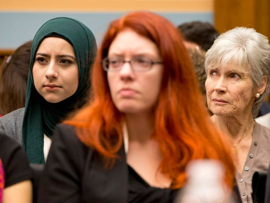 Women in the audience listen on Capitol Hill in Washington, Thursday, Nov. 19, 2015, during the House Immigration and Border Security subcommittee hearing to examine the Syrian refugee crisis and its impact on the security of the U.S. Refugee Admissions Program. (AP Photo/Jacquelyn Martin)
