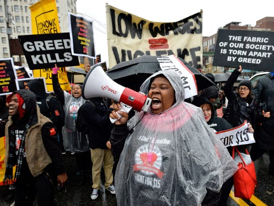 Nationwide protests, like this one at a McDonald's in Harlem, N.Y., have helped the push to raise the minimum wage.