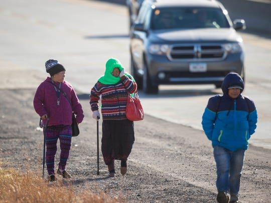 Rupa, Priti, Badu Rai walk along 63rd in Des Moines to get to the Dollar General Store for groceries Wednesday, Dec. 6, 2017. It is over a mile and a half from their apartment to the nearest grocery store with out public transportation.