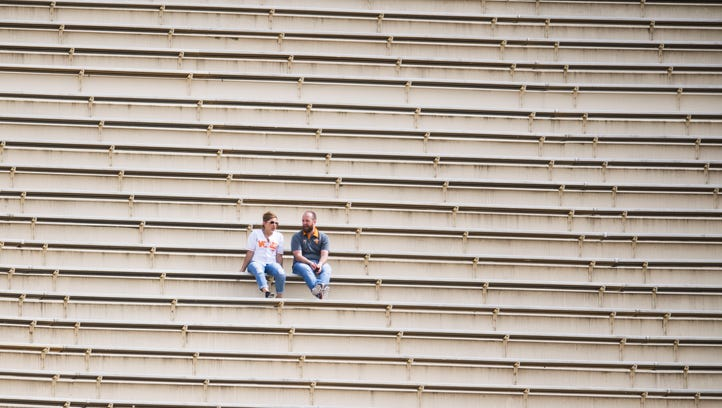 Tennessee fans sit in the stands during the Tennessee