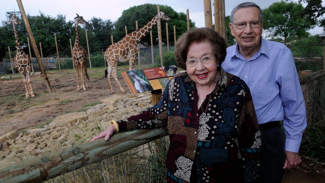 Gail and Joe Russey stand beside the giraffe exhibit at the Abilene Zoo Tuesday Sept. 26, 2017. The couple will be honored Saturday during Zoobulation, an annual gala fundraiser.