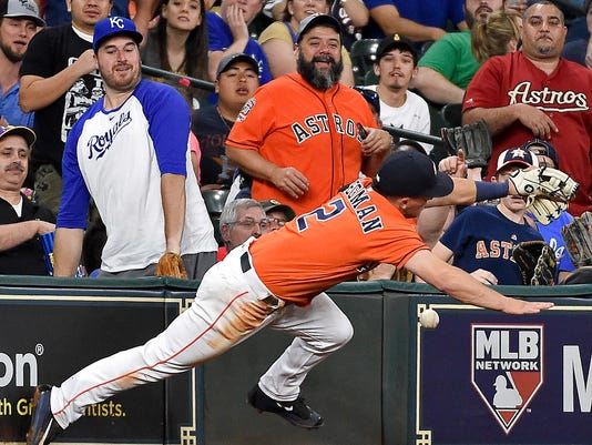Houston Astros third baseman Alex Bregman misses a foul ball by Kansas City Royals' Brandon Moss during the fourth inning of a baseball game, Friday, April 7, 2017, in Houston. (AP Photo/Eric Christian Smith)