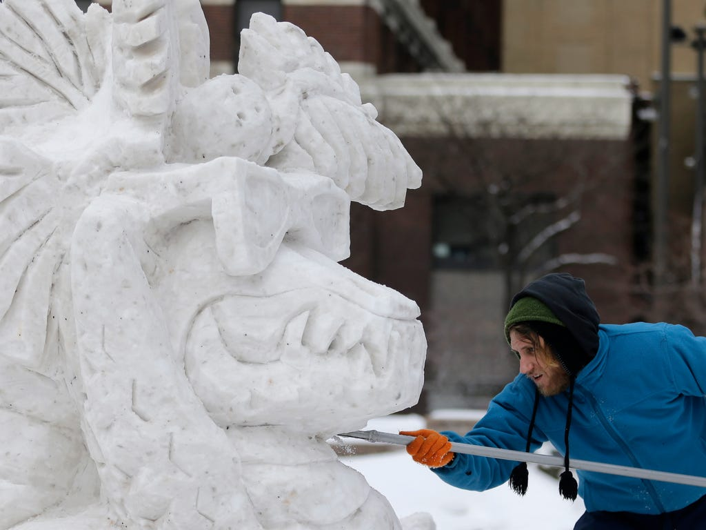 Joseph Gagnepain works on a snow sculpture in downtown Cleveland.