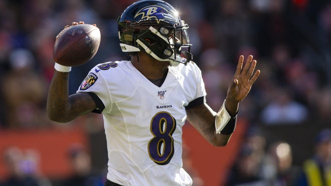 Dec 22, 2019; Cleveland, Ohio, USA; Baltimore Ravens quarterback Lamar Jackson (8) throws the ball against the Cleveland Browns during the first quarter at FirstEnergy Stadium. Mandatory Credit: Scott Galvin-USA TODAY Sports