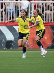 Lady Andrade (16) celebrates with Colombia midfielder Natalia Gaitan (3) after scoring a goal during the first half against France at the Women's World Cup.
