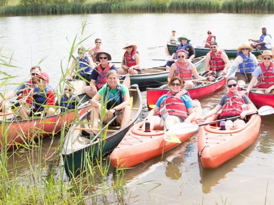 Photos by David Miller  Paddlers take a break from the Canoe Evansville trip two years ago.