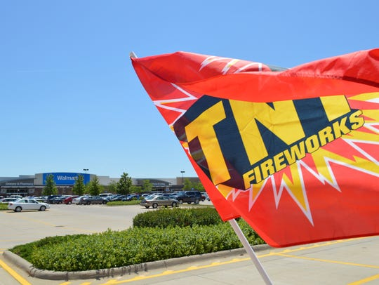 A flag flies outside of a TNT fireworks stand in the