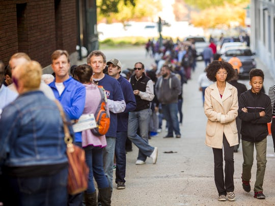 Hundreds stand in line to vote early at the Hamilton County Board of Elections on Broadway Street in Cincinnati Saturday, November 5, 2016.  The line wrapped around the building and took approximately one hour and twenty minutes. The Board of Elections offers early voting Sunday, November 6 from 1 p.m. to 5 p.m. and Monday, November 7 from 8 a.m. to 2 p.m.