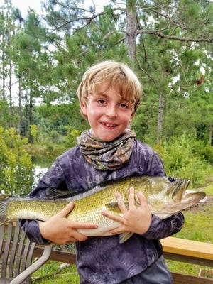 "Savannah's Alton Smith, 8, caught this monster largemouth bass in a pond at his family's farm in Odum, Georgia on July 18. The catch measured in at 26.5 inches and weight 12 pounds, 12 ounce. His parents, Josh and Dana Smith, agreed to have it mounted. Alton was fishing by himself with a spinning rod and #10 braided line. He tied the knot himself and used a side-hooked artificial lure. He ""invented"" this wacky rig himself to tempt the bass."