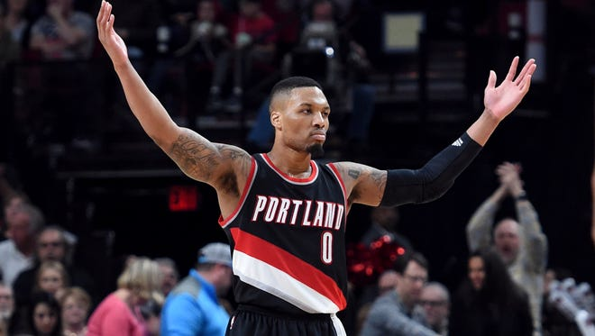 Portland Trail Blazers guard Damian Lillard acknowledges the crowd during the second half of the team's NBA basketball game against the Utah Jazz in Portland, Ore., Saturday, April 8, 2017.