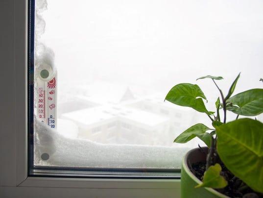 636159259958957921-stock-photo-496209006-winter-window.jpg