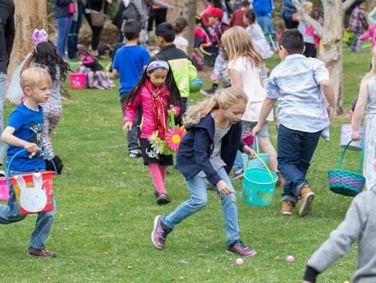 Children race to pick up Easter eggs during the Community