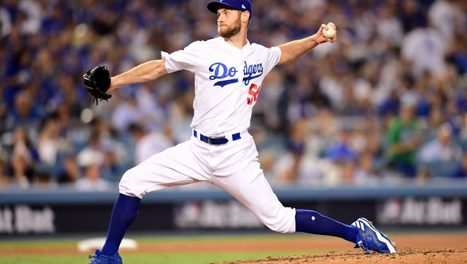 Former Blue Wahoos pitcher Tony Cingrani, shown pitching against Chicago Cubs last week in NL Championship Series, became the Wahoos first player in World Series