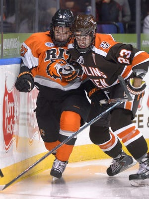 RIT's Alex Perron-Fontaine and Bowling Green's Brent Tate battle for the puck along the boards on Oct. 17, 2015.